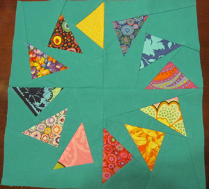 "Circle of Geese block (click the picture to hear Meredith's composition ""Flock of Geese"")"