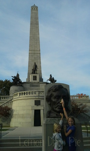 Rubbing Lincoln's nose for good luck.