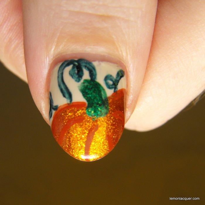 Pumpkin nail art on thumb