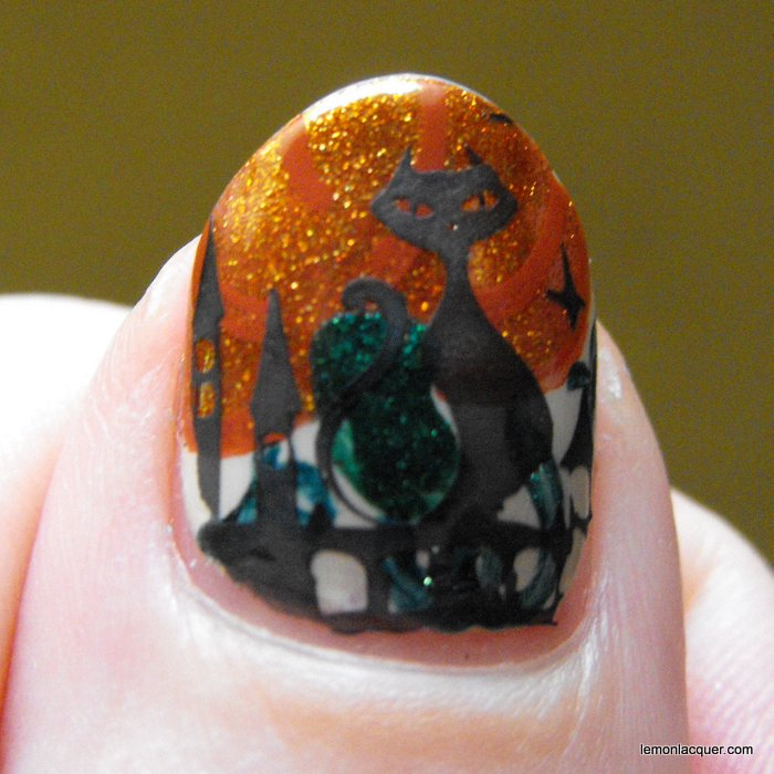 Stamping over pumpkin nail art to test a polish. Ruined! :)