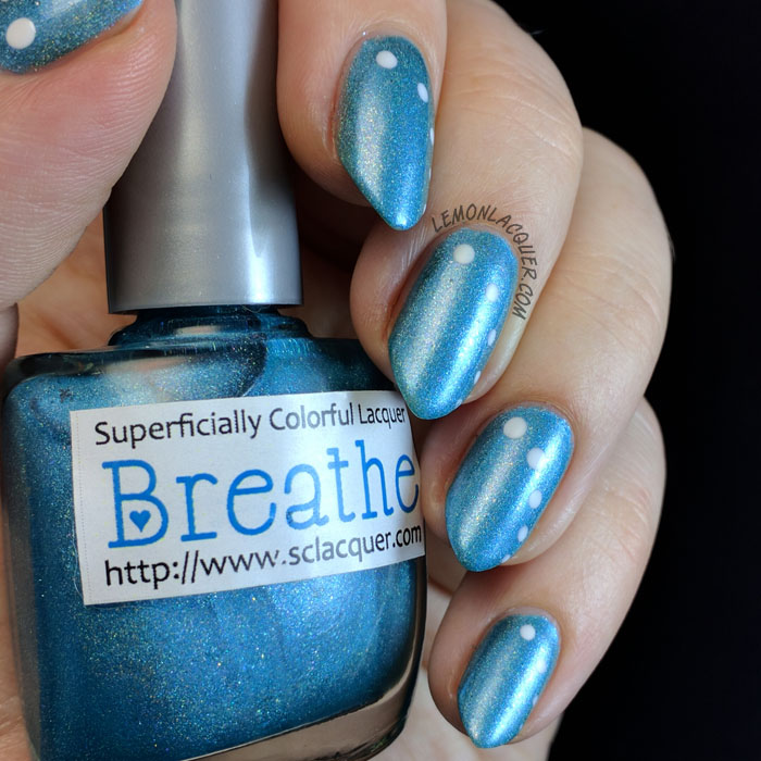Simple white dots over blue holo nail polish