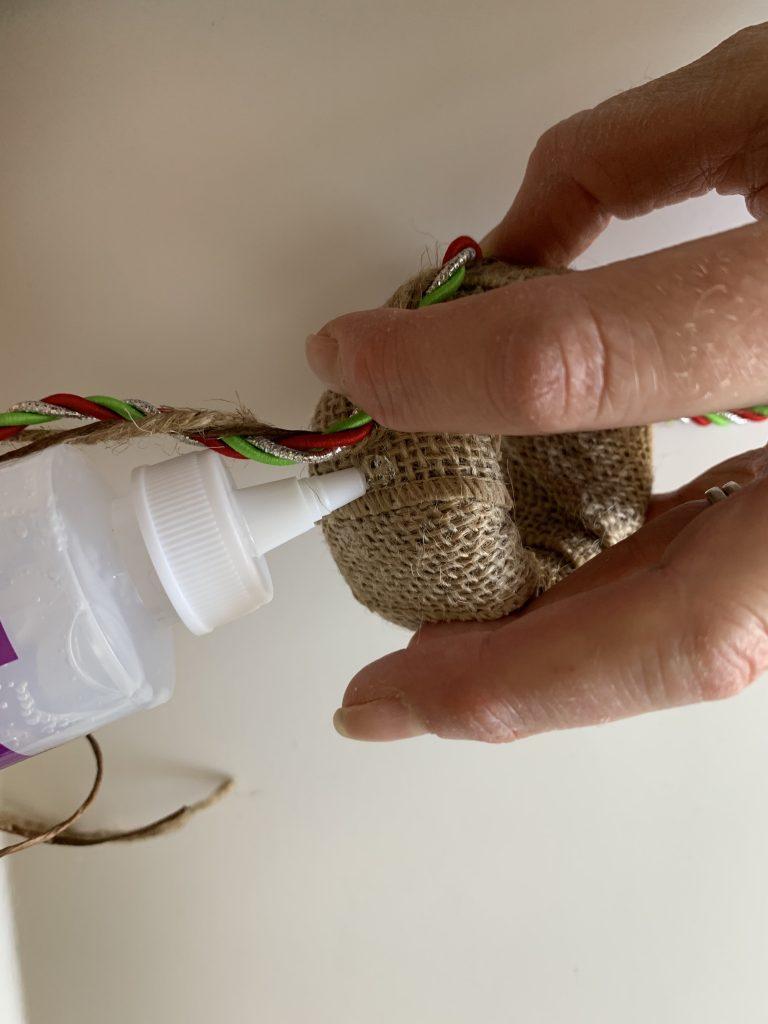 Glue ribbon around DIY Christmas napkin ring