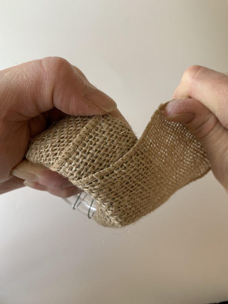 Tightly wrapping burlap around DIY Christmas Napkin Ring