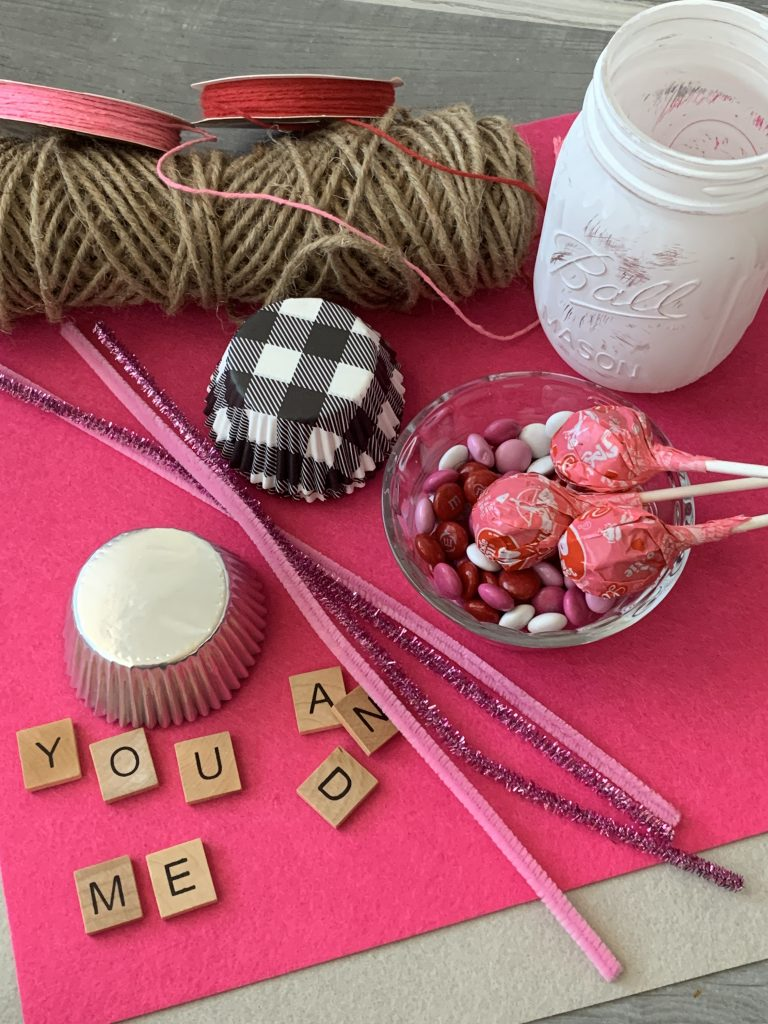 scrable letters, candy, cupcake liners and pipe cleaners for diy valentines mason jar bouquet