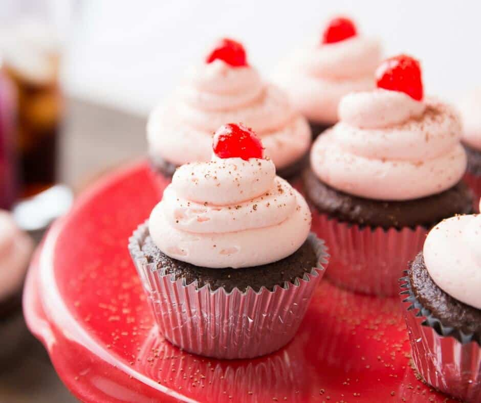 Everyone loves cupcakes, and I know you are going to love these fun Cherry Coke Cupcakes! The chocolate cake and the cherry buttercream are amazing together!