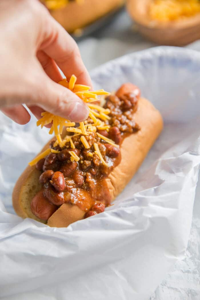 chili dog topped with cheese