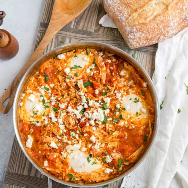 Mediterranean Breakfast Baked Eggs skillet with bread