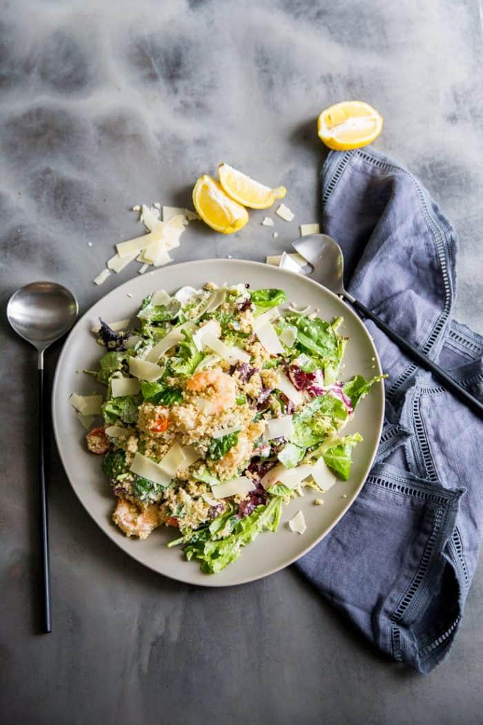 Shrimp Caesar salad serving spoon on the side