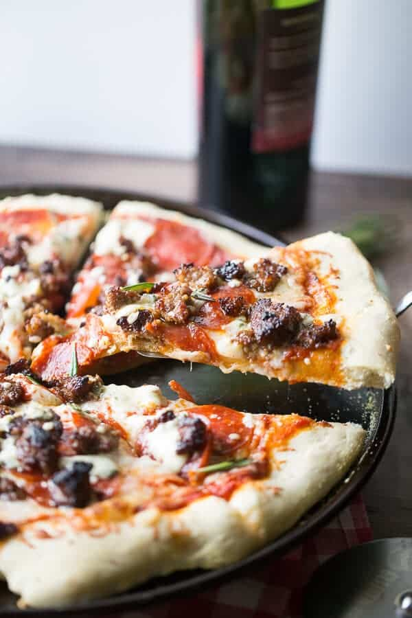 Italian sausage pizza slice being served