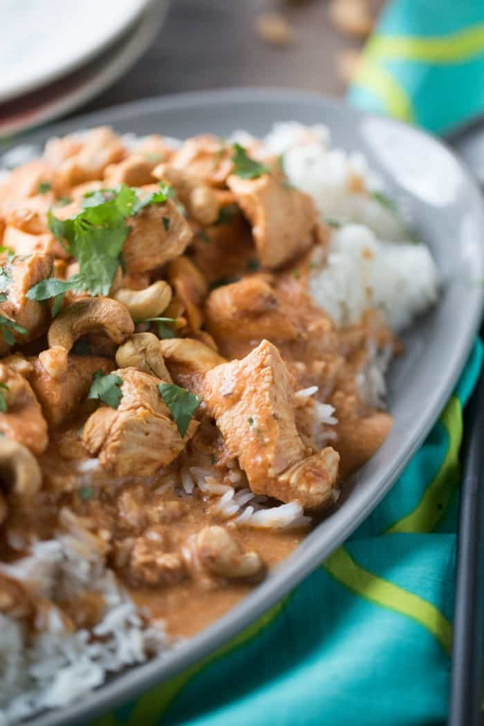 A simple chicken curry recipe made with cashews, cashew milk, and a hadnful of spices! You won't believe how easy and delicious this recipe is! lemonsforlulu.com