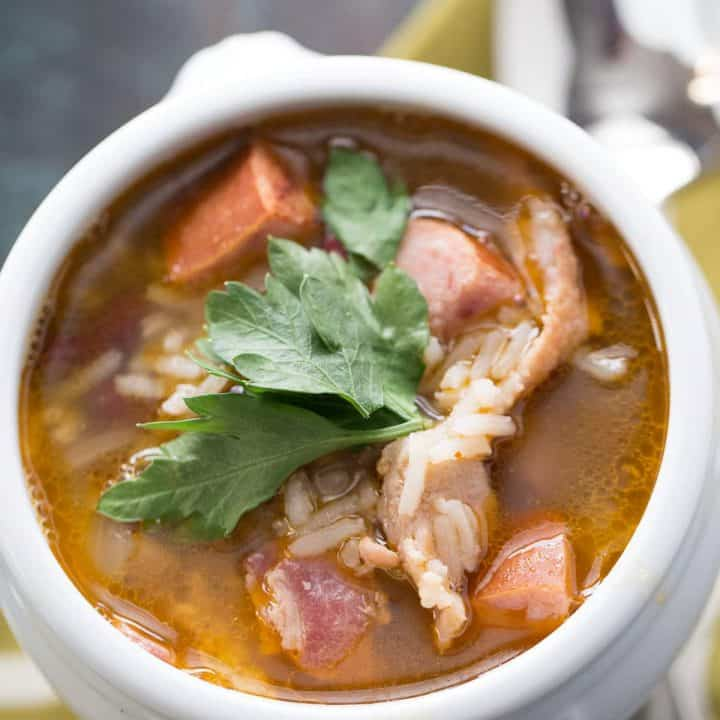 Red beans and rice are mixed with bacon and andouille sausage for flavorful and filling soup recipe! lemonsforlulu.com