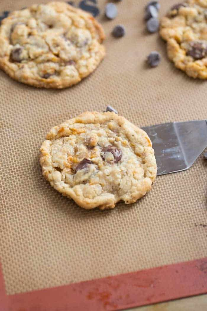 Three Butterfinger cookies surrounded by chocolate chips.