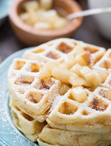 Homemade waffles made with browned butter and topped with rum spiced pears!