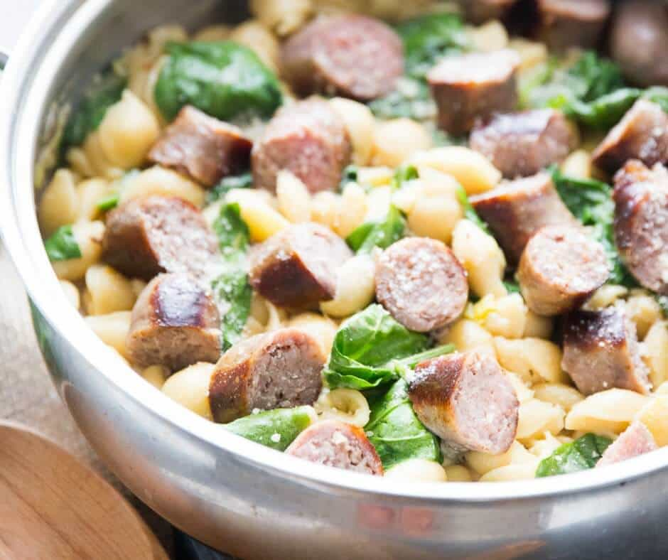 This light and creamy sausage pasta is luscious and flavorful. The spinach and leeks add color and freshness to this no-fuss recipe. This is a great meal for busy nights!'