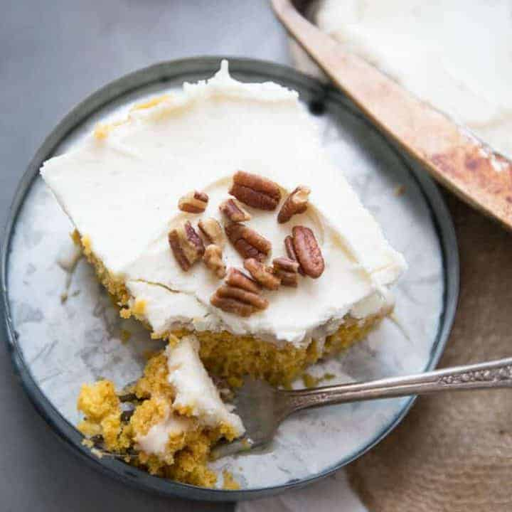 Love a good pumpkin roll but don't want to put in the time? I have just the solution! This easy poke cake takes everything we love about pumpkin rolls and turns it into an easy to assemble cake!