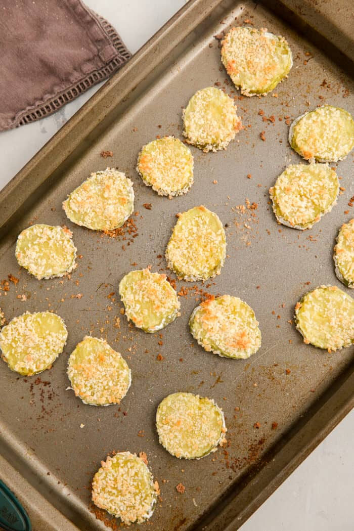 baked pickles on a baking sheet