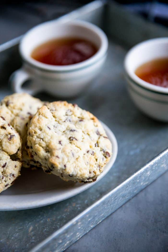 chocolate chip scone with two cups of tea