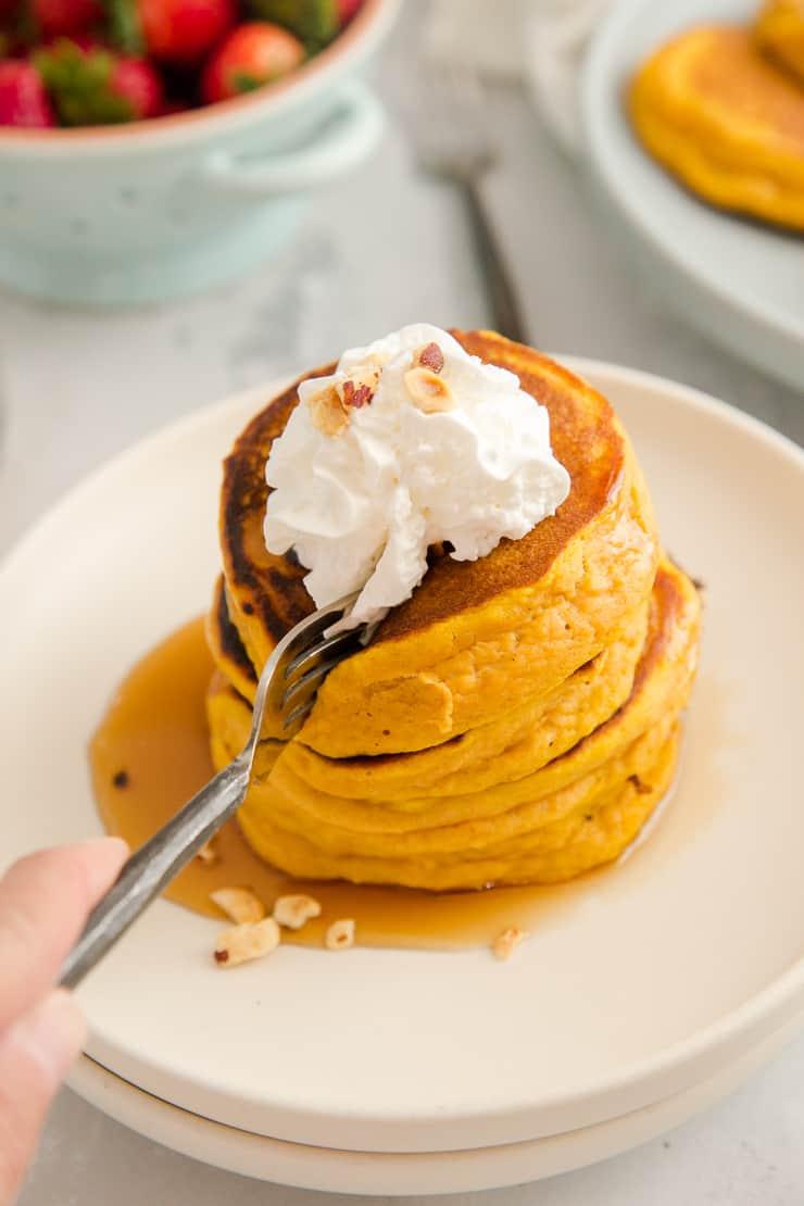 fork cutting through a stack of pumpkin pancakes