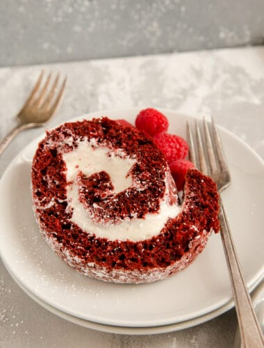 red velvet cake roll slice with a fork on the side