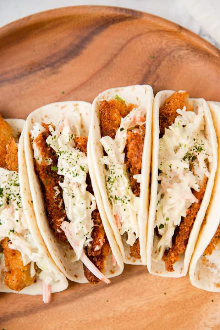 close up of 3 fish tacos