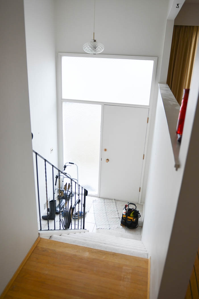 A Diy Split Level Entry Makeover Before After Lemon Thistle | Split Level Entry Stairs | Wood | Half Wall | Stairwell | Raised Bungalow | Interior