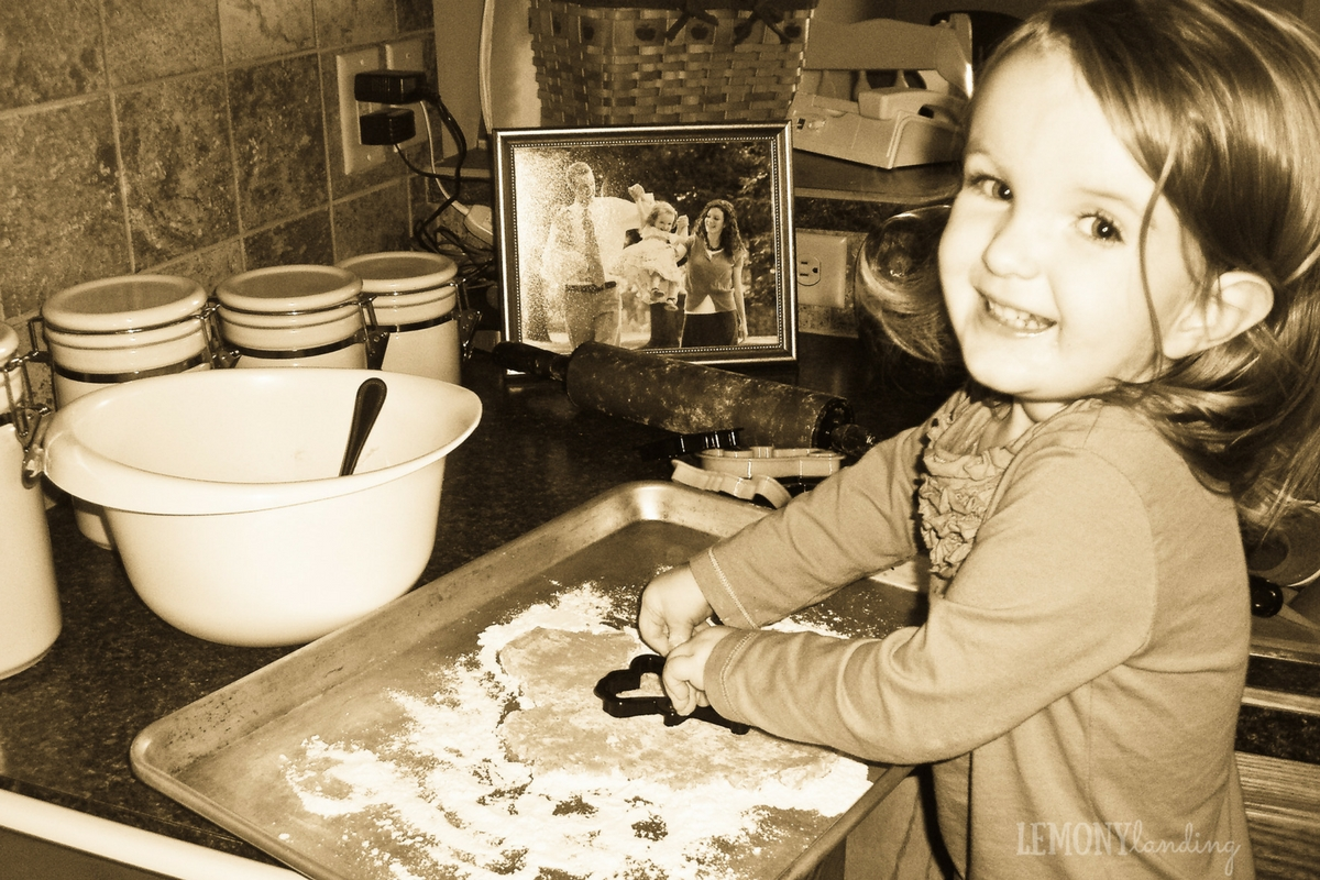 Back in the day, two-year-old Maggie cutting out Halloween cookies