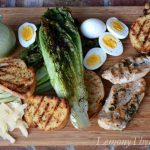 Grilled Caesar Salad with Herb Grilled Chicken & Shrimp