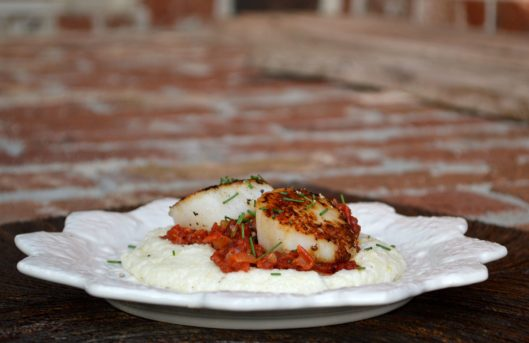 Herb Infused Grits topped with Tomato Bacon Jam & Seared Sea Scallops