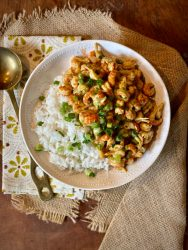 The crawfish tails in Crawfish Étouffée are bursting with cajun spices balanced by the buttery roux and mild white rice.