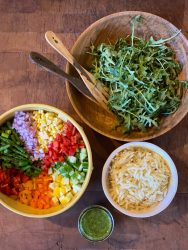 Spring Chopped Salad Ingredients including veggies, arugula, orzo and herb vinaigrette