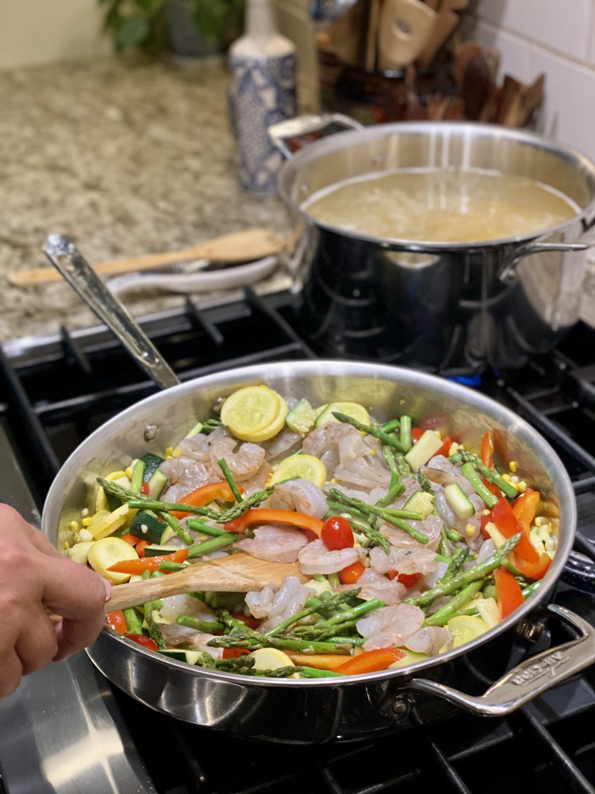 Large skillet with sautéed shrimp & summer veggies