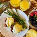 Sweet Potato Eggs Benedict Finished Plate with side of Hollandaise and berries