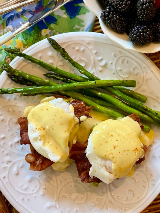 Sweet Potato Eggs Benedict with bacon, Hollandaise and a side of asparagus