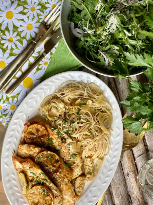 Chicken Francaise With Artichoke Hearts over spaghetti served with an Arugula Salad