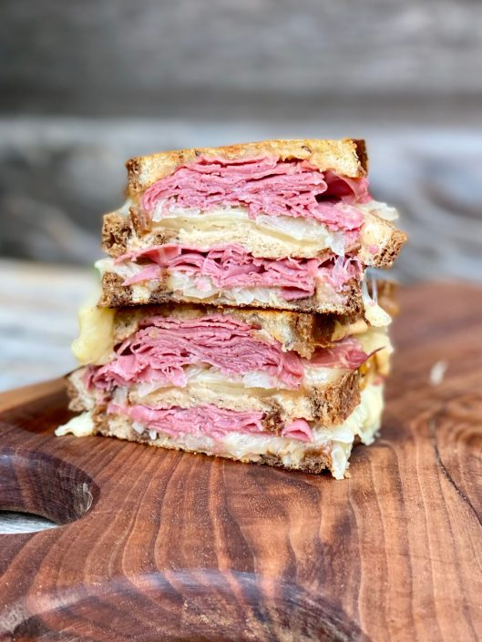 The Classic Reuben Sandwich with homemade Russian dressing on marble rye bread