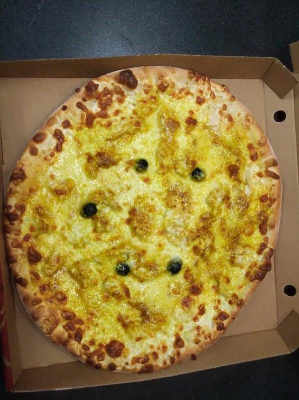 Pizza artisanale à base de curry
