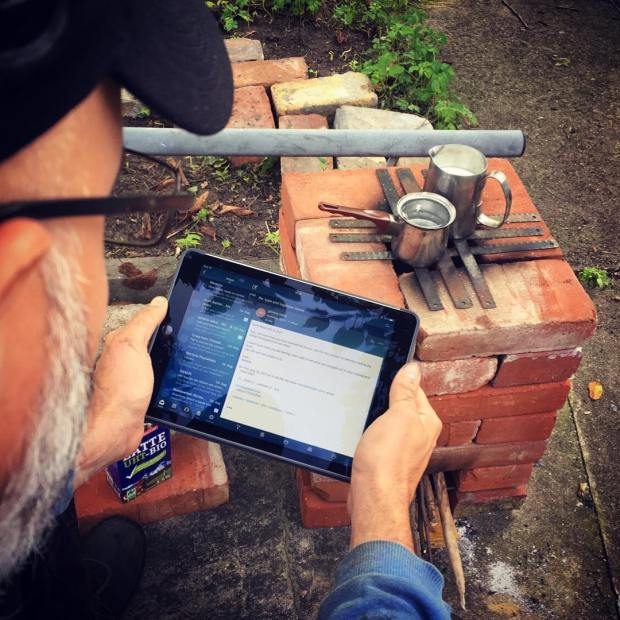 Checking emails and watching the milk… Garden camping morning routine