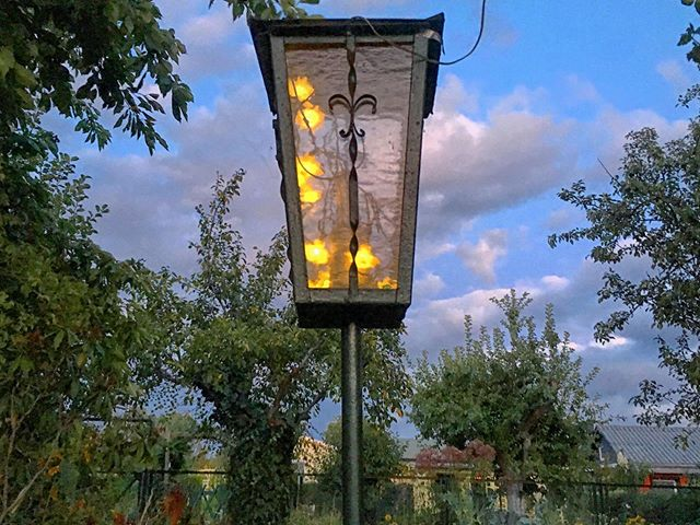 Evening view. We rigged solar lights inside the old varanda lamp.