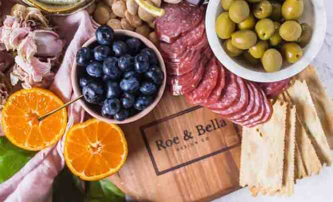 The perfect step by step EPIC CHARCUTERIE BOARD FOR TWO makes for a great no cook idea to share with someone special on love day. A little sweet, savory and served with love. lenaskitchenblog.com #charcuterie #valentinesday #cheeseboard
