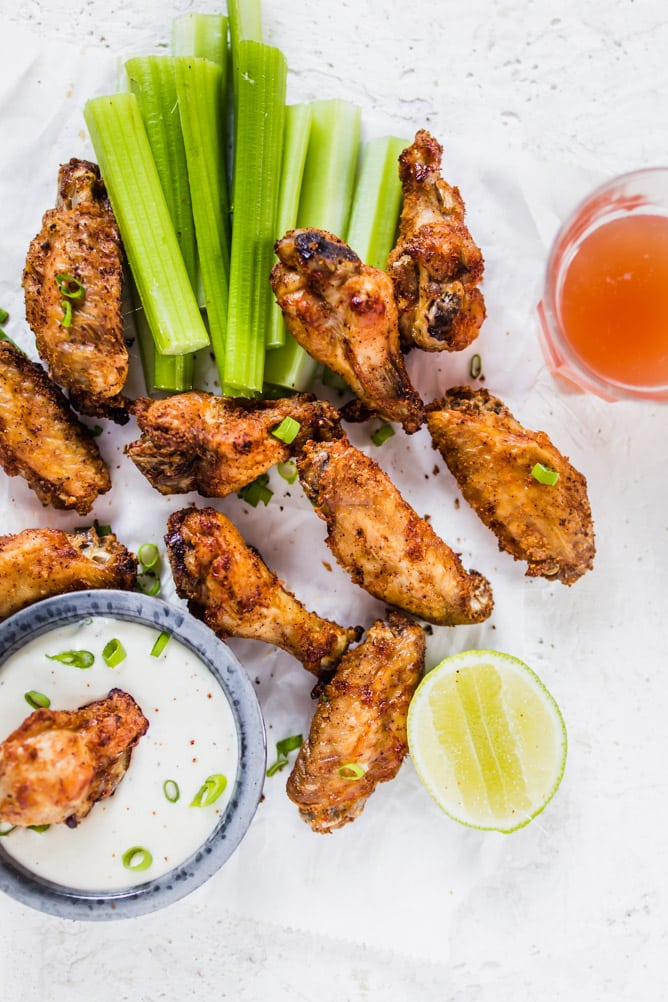 Extra Crispy Air Fryer Wings up close with ranch dressing and celery. lenaskitchenblog.com