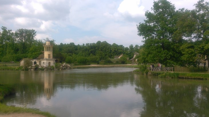 The Totally Real Lake™ in Marie Antoinette's village, with the Very Useful Lighthouse™, which has guided many a villager safely back home back in the day.