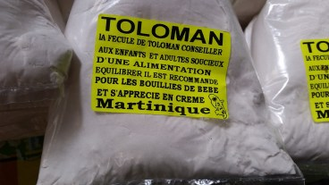 Toloman is apparently arrowroot in English
