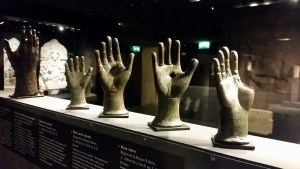 several hands made from bronze, inscribed with wishes (votives)
