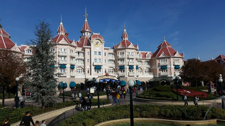 Disneyland entrance area with a building with many turrets