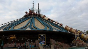 A building with a tent like roof and protruding antannae