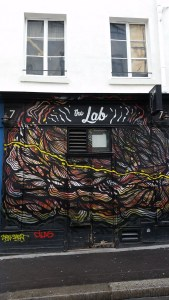 Fancy graffiti covers the front of a bar called the Lab