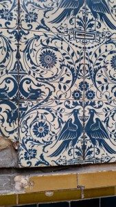 Tiles with blue birds, ornaments and flowers on whitebackground