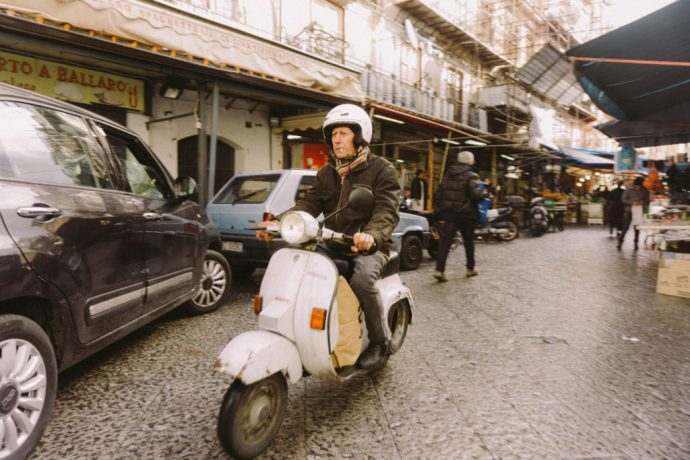 Man riding original italian vespa