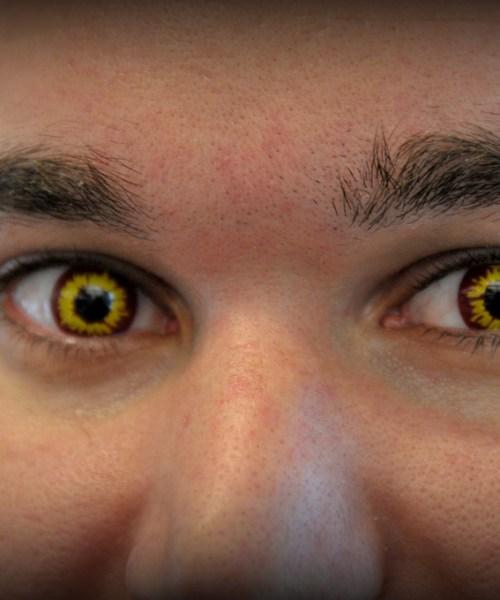 olho com lente amarela