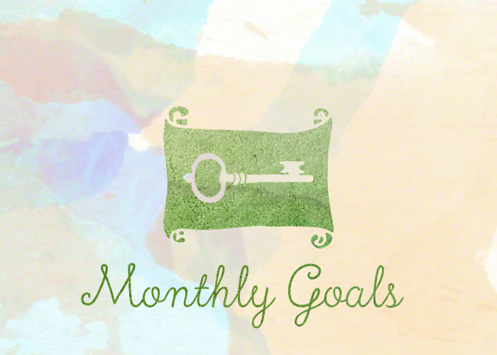 Monthly Goals. The text 'monthly goals' underneath a scroll with a key on it. A look back at my goals of the month.